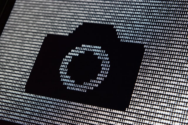 camera icon surrounded by binary code